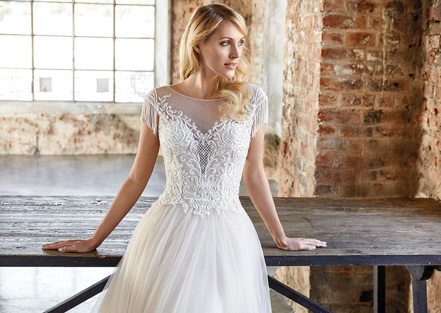 O amor é visível no olhar da noiva e o glamour está lá, em cada peça Amour Glamour by Noivos de Gondomar